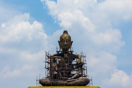 Giant Buddha sitting with blue sky background