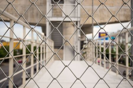 orthographic symbol: Shallow depth of field close-up of chain link fence Stock Photo