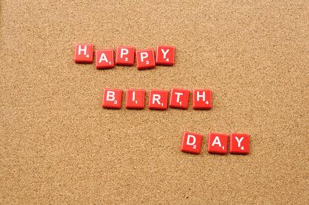 Happy birthday crossword on wooden board photo