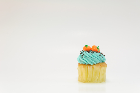 One bluecream with pumpkin cupcake on white background