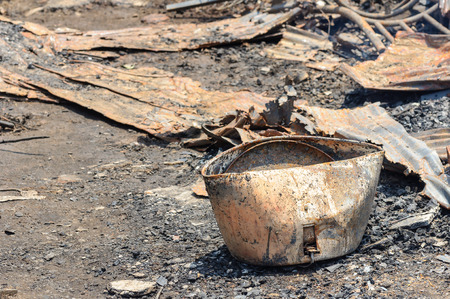 tragedies: Close up damage rice cooker caused by fire in Thailand.