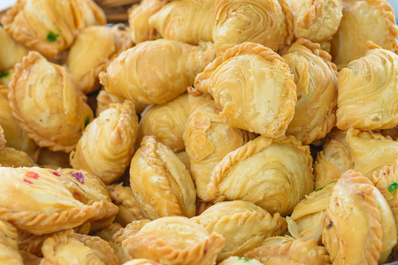 Close up spinner curry puff Malaysian favourite on detail. Stock Photo