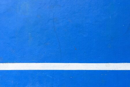 Blue concreate with white strip rough surface background.