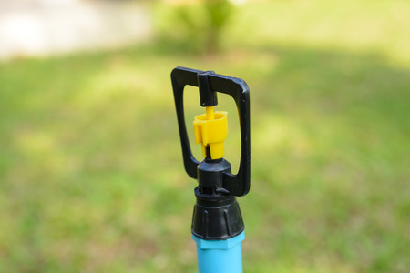Close up head of water sprinkler plastic made.