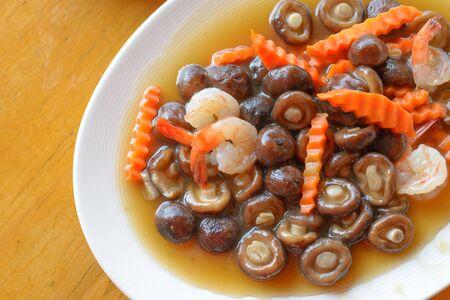 Stir fried mushroom, carrot and shrimp in oyster sauce