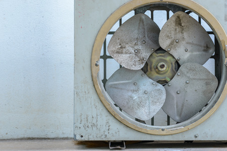 Old rusty air conditioner. on white wall background