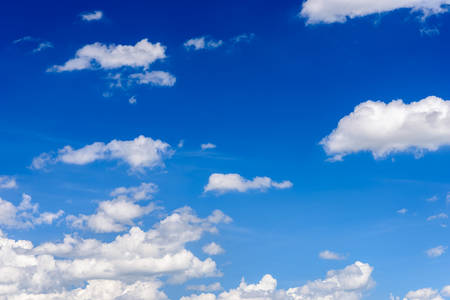 clear sky: Bright clear blue sky with white clouds. Stock Photo