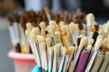 Close up hair of paintbrush, shallow focus on foreground, leaving space on left side. Stock Photo
