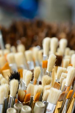 Close up hair of paintbrush, shallow focus on midground.