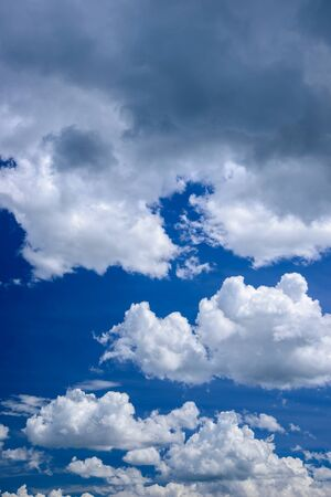 Bright clear blue sky with white clouds. Stock Photo