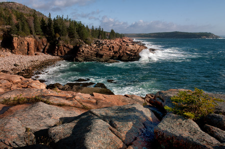 Rocky Acadia Coastline of Maine where the water of the ocean hits the rocks.