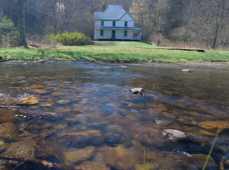 Townsend, TN April 15, 2008:  Historic Hiram Caldwell House Building with Rough Fork stream in front in the Cataloochee Historic Area of the Great Smoky Mountains National Park.