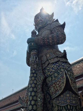 The Grand palace with giant statue in Thailand