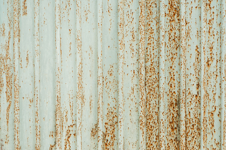 Rusty faded gray fence background texture. Iron old fence close-up Imagens