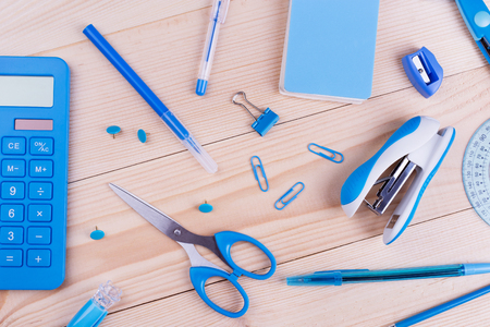 Blue stationery objects close-up. School creative desk with blue stationery. Back to school and education banner