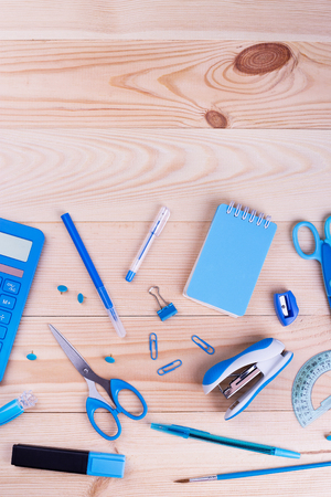 School, office supplies on wood background. Stationery in blue color. Blue back to school concept. Stock Photo