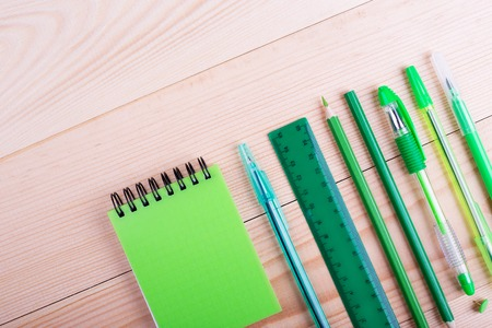Office table with space, green stationery. Creative desk with green stationery. Office supplies products Stock Photo