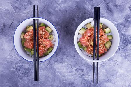 Two plates with poke. Dish from rice, fish, avocado. Beautiful hawaiian dish