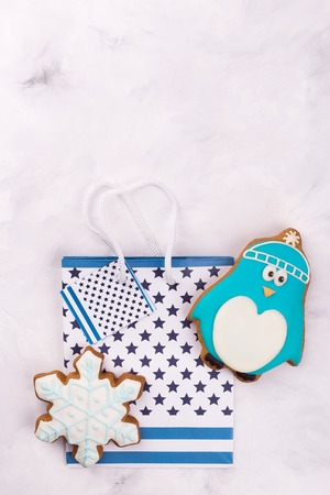 Gingerbread penguin, snowflake, package. Place for congratulations near gift
