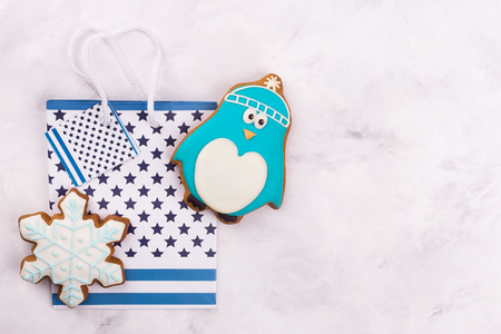 Gingerbread penguin, snowflake, package, free place. Place for congratulations near tasty gift
