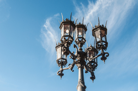 Antique street lamp against background of clouds. Large street lamp with five lamps Stock Photo