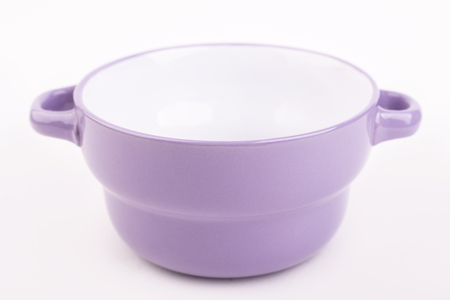 Violet tureen with handles isolate. Bright soup dishes on white background