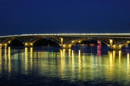 Night view of river and bridge with lights. Fireworks, bridge, night surface. Kiev, Ukraine Stock Photo