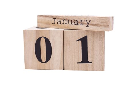 Wooden calendar January first isolate. Light calendar made of wood on white background. Holiday time, New Year Banque d'images