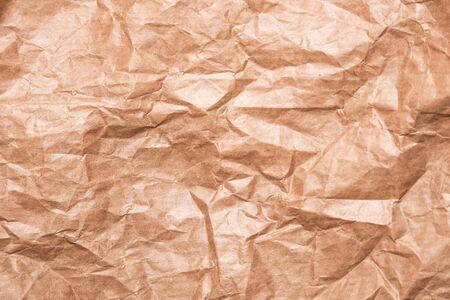 Crumpled paper background vignette. Crumpled kraft paper close-up Stock fotó