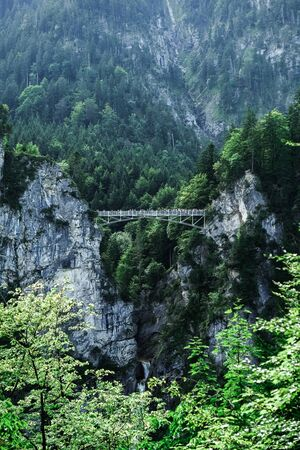 The ancient iron bridge of Mary over the deep abyss between the rocks 版權商用圖片