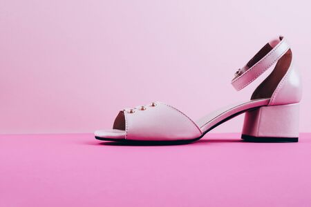 Pure pink glamour shoes on heels, bright pink background Stock Photo