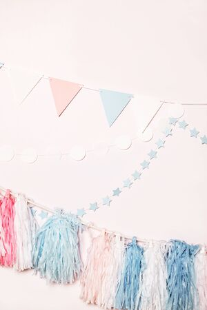 Bright colorful birthday decoration in pastel colors against a white wall