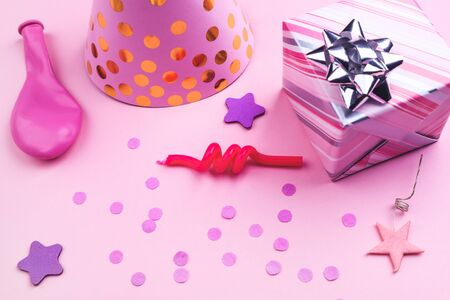 Girls party accessories and gift box over the pink background, birthday concept
