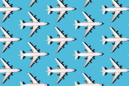 Toy airplane with shadow pattern on a bright blue background