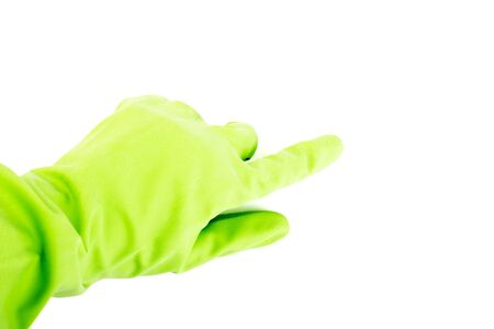 Hand in green glove wiping isolated. Green rubber glove on hand on white background 写真素材