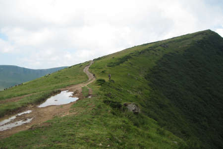 Dirty mountain trail high above sea level, difficulty in hiking. Carpathian, Ukraine