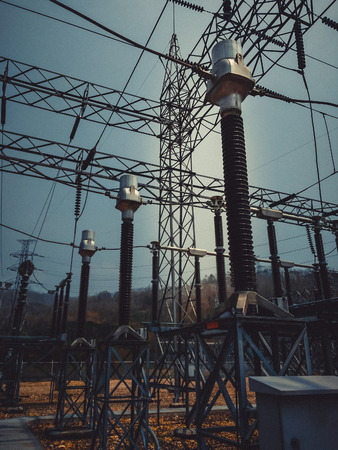 isolator insulator: Vintage photo of high voltage power lines and transformers