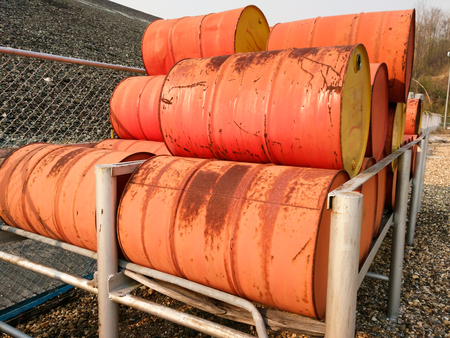 stacked up: Oil barrels or chemical drums stacked up