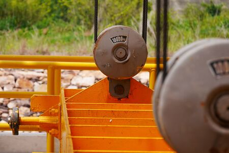 lift gate: Yellow pulley with steel cables used in lift downstream gate Stock Photo