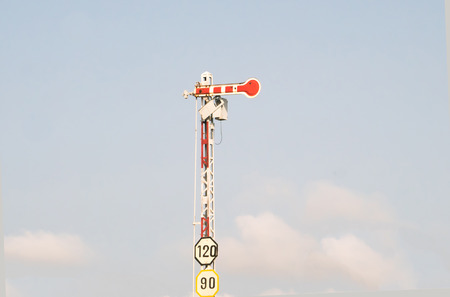 Electric poles with label sign limited speed of train.