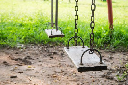 play the old park: Old wooden swing in playground