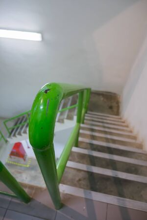 closeup, green railing  Stairs in factory