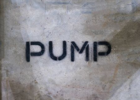 Text PUMP by spraying on the cement wall. Stok Fotoğraf