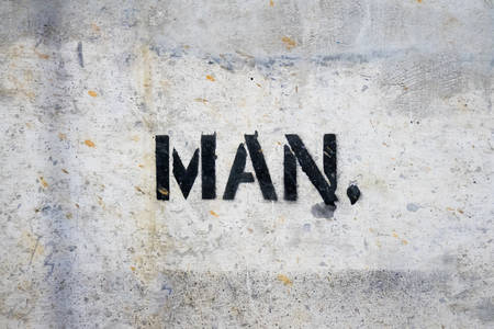 Text MAN by spraying on the cement wall.