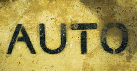 Text AUTO by spraying on the cement wall. Stok Fotoğraf