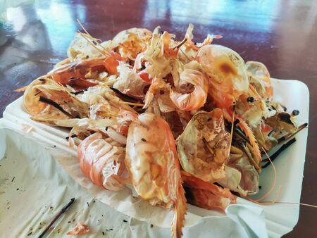 Shrimp shell waste on foam box after eating. 版權商用圖片