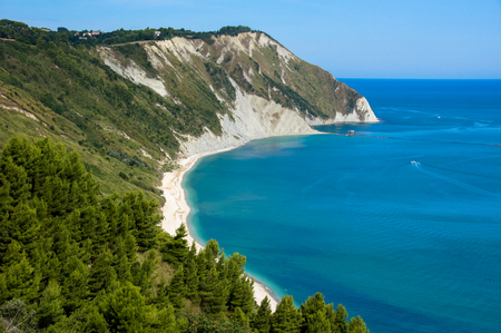 View of the Adriatic coast in the Marche region of Italy. Beach called Mezzavalle near the town of Ancona. Фото со стока