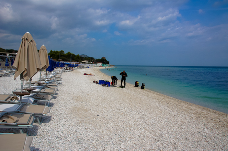 Rocky beach in Portonovo in the Regional Park of Conero, Adriatic coast in Italy. Cloudy weather announces the coming storm. Photo taken in August 2016.