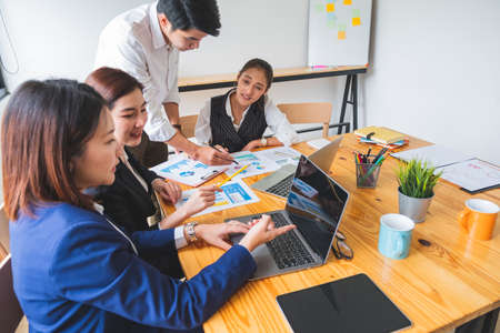 Group of young asian entrepreneur in business casual brainstorming new project