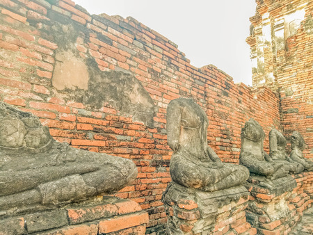 Buddha statue no head Wat Chaiwatthanaram temple in Ayuthaya Historical Park Stock Photo